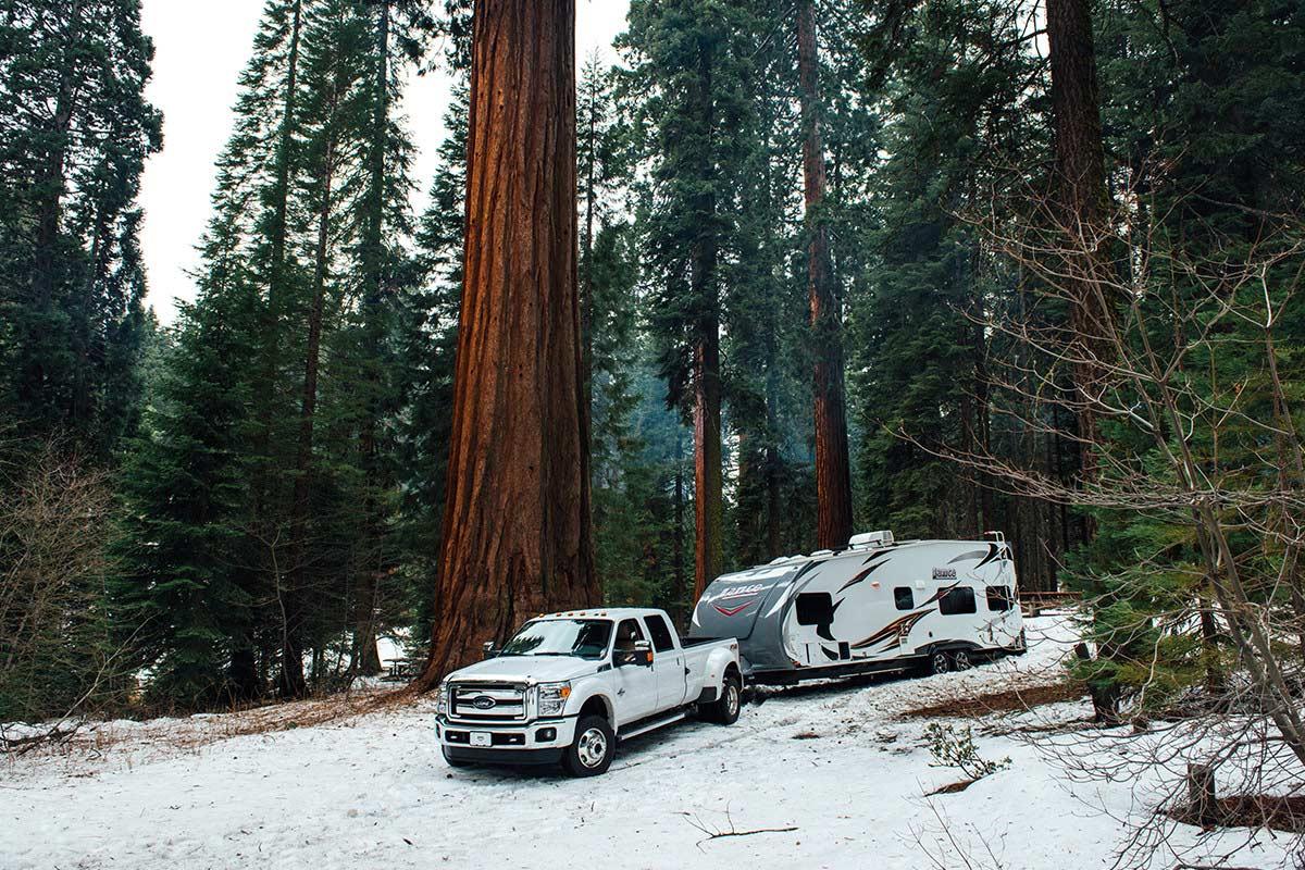 Winter RVing winterizing rv camping winter travel trailer truck snow forest