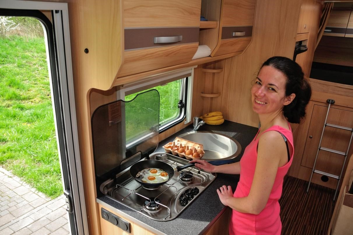 Woman cooking in an Rv