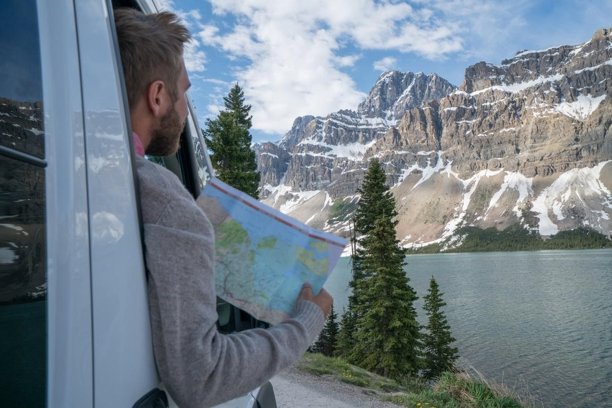 RVer holding a map next to a lake