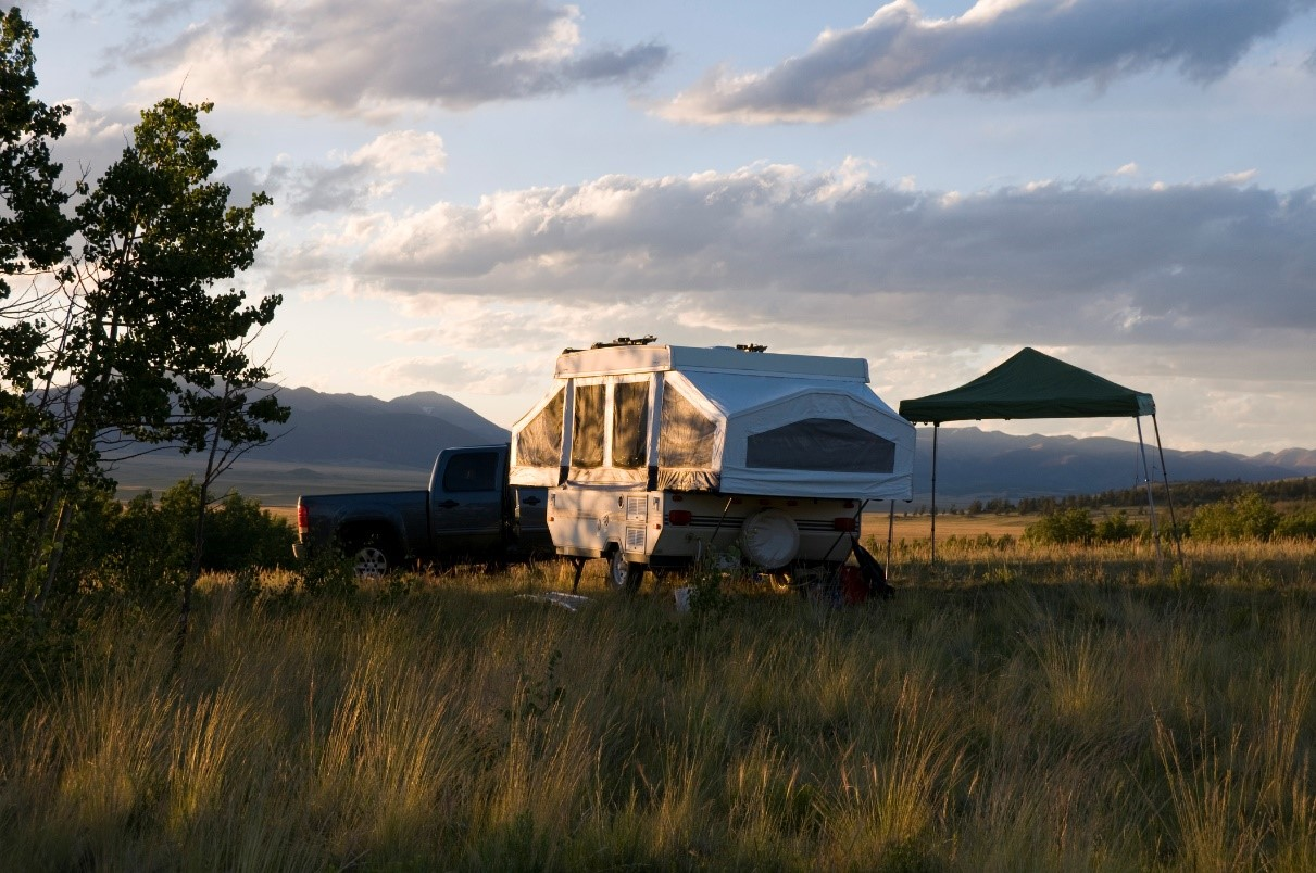 Shot of a pop-up camper set up in a field