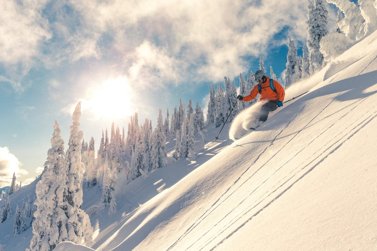 skier carving down a mountain