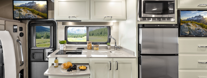 RV kitchen with refrigerator and countertop decorations