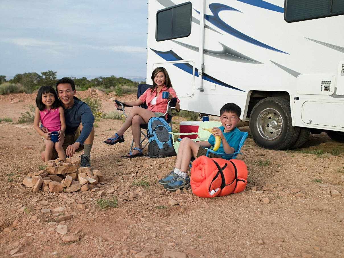 Family out camping with an RV