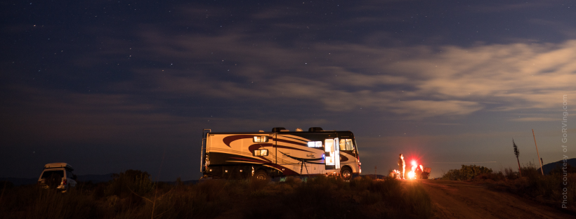 RV dry camping outdoors at night