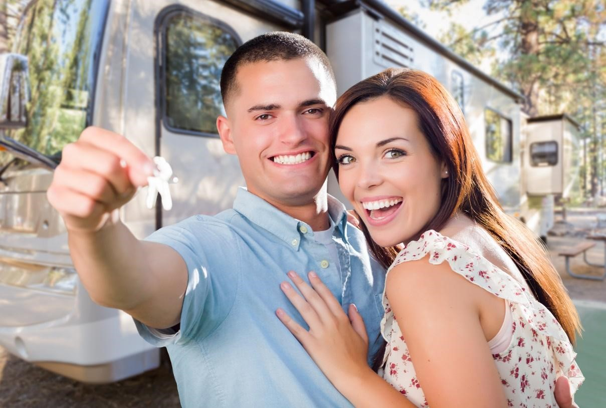 Couple celebrating purchasing a new RV